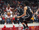 Portland Trail Blazers forward Al-Farouq Aminu, left, is defended by Brooklyn Nets forward DeMarre Carroll, center, and center Jarrett Allen during the first half of an NBA basketball game in Portland, Ore., Monday, March 25, 2019. (AP Photo/Randy L. Rasmussen)