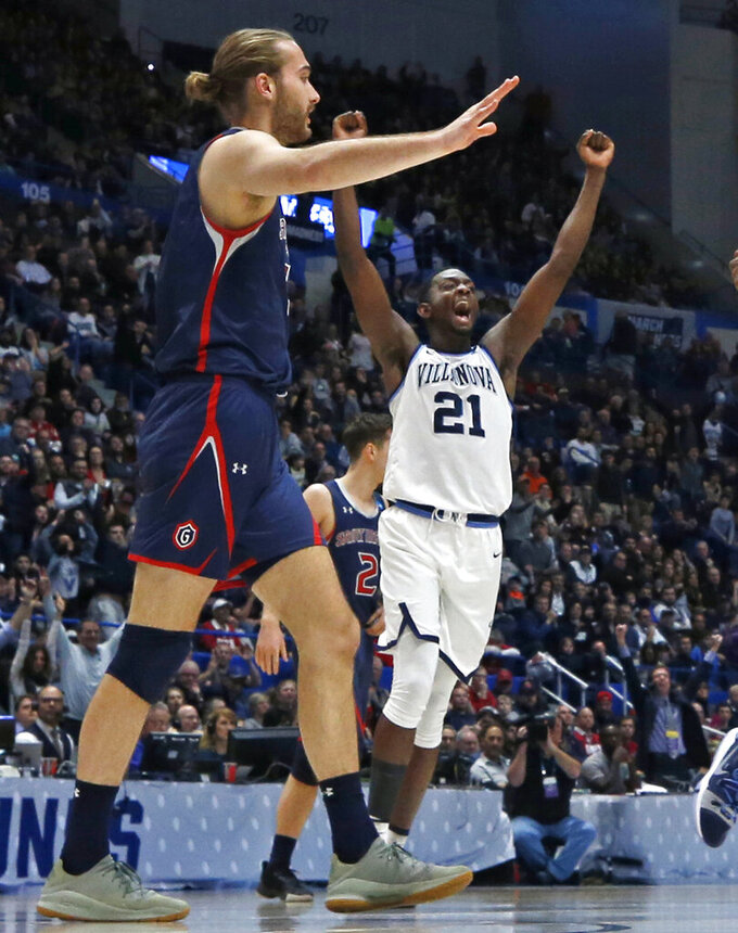 Villanova's Dhamir Cosby-Roundtree (21) celebrates a victory as St. Mary's Jock Perry, left, walks off after a first round men's college basketball game in the NCAA Tournament, Thursday, March 21, 2019, in Hartford, Conn. (AP Photo/Elise Amendola)