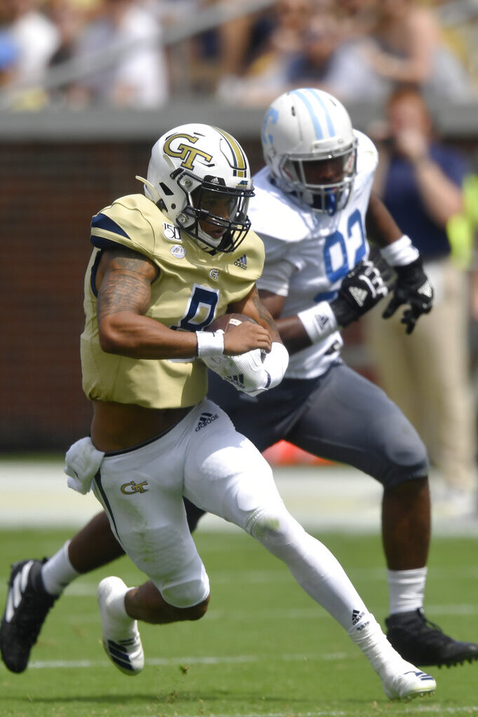 Georgia Tech quarterback Tobias Oliver (8) runs against the Citadel defensive lineman Aaron Brawley (92) during the first half of an NCAA college football game, Saturday, Sept. 14, 2019, in Atlanta. (AP Photo/Mike Stewart)