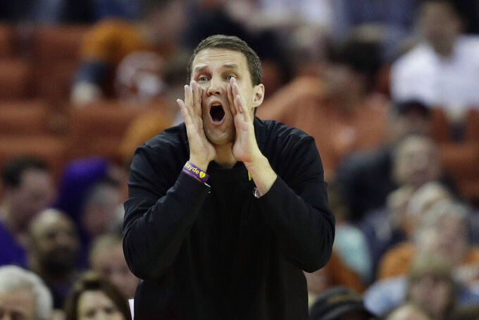 FILE - LSU head coach Will Wade call to his players during the first half of an NCAA college basketball game against Texas in Austin, Texas, in this Saturday, Jan. 25, 2020, file photo. Wade was able to add more size and on-the-ball scrappiness to his roster this season and expects it to show up in a big way when the Tigers are defending. (AP Photo/Eric Gay, File)