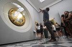 Visitors admire Renaissance painter Michelangelo Buonarroti's painting