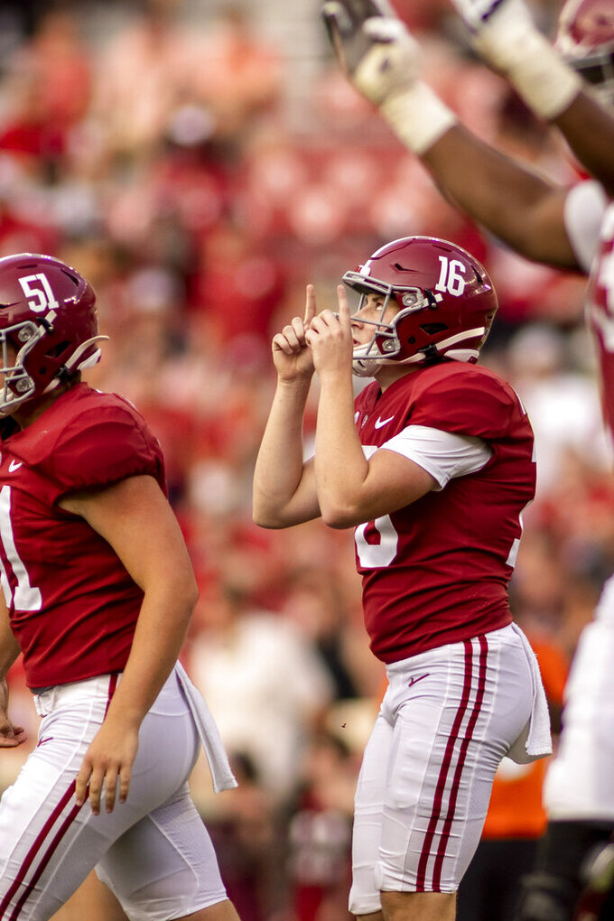 Alabama kicker Will Reichard (16) salutes the sky after his field goal during the second half of an NCAA college football game against Mercer, Saturday, Sept. 11, 2021, in Tuscaloosa, Ala. (AP Photo/Vasha Hunt)