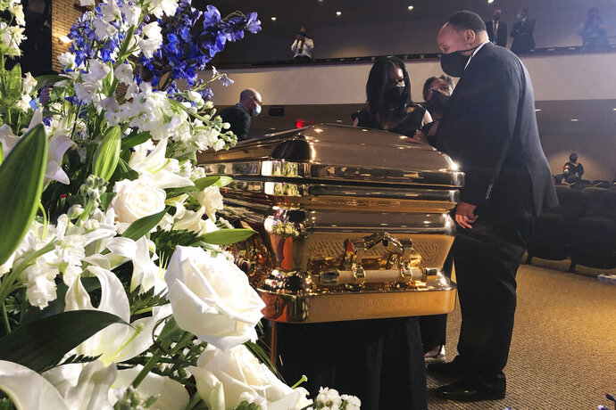 Martin Luther King III takes a moment by George Floyd's casket Thursday, June 4, 2020, before a memorial service for George Floyd in Minneapolis. (AP Photo/Bebeto Matthews)