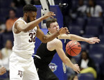 Texas A&M forward Josh Nebo (32) and Vanderbilt forward Yanni Wetzell reach for a rebound in the second half of an NCAA college basketball game at the Southeastern Conference tournament, Wednesday, March 13, 2019, in Nashville, Tenn. Texas A&M won 69-52. (AP Photo/Mark Humphrey)
