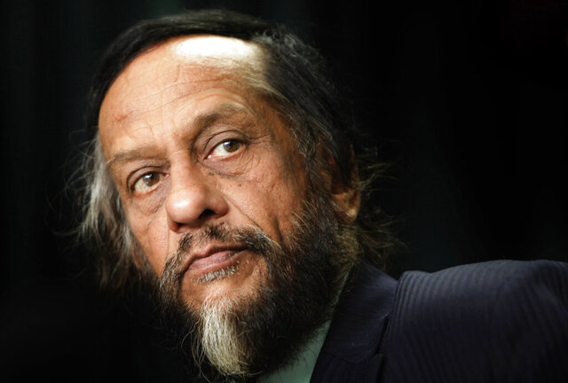 FILE- In this Dec. 1, 2009, file photo, Rajendra Kumar Pachauri attends a press conference in New Delhi, India. The Indian environmentalist, under whose chairmanship the UN's Intergovernmental Panel on Climate Change won the Nobel Peace Prize alongside former U.S. Vice President Al Gore in 2007, has died after a heart surgery. Pachauri's death was announced late Thursday, Feb. 13, 2020, by The Energy and Resources Institute, or TERI, a  research group he headed until 2016 in New Delhi. He was 79. (AP Photo/Gurinder Osan, file)