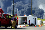 Firefighters arrive at the site where the Intercontinental Terminals Company petrochemical fire reignited, Friday, March 22, 2019, in Deer Park, Texas.  The efforts to clean up a Texas industrial plant that burned for several days this week were hamstrung Friday by a briefly reignited fire and a breach that led to chemicals spilling into the nearby Houston Ship Channel. (Godofredo A. Vasquez/Houston Chronicle via AP)
