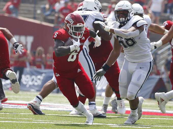 Fresno State running back Jordan Wilmore (6) heads through the line against Connecticut during the second half of an NCAA college football game in Fresno, Calif., Saturday, Aug. 28, 2021. (AP Photo/Gary Kazanjian)
