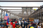 Protesters march on the Brooklyn Bridge after a rally in Cadman Plaza Park, Thursday, June 4, 2020, in New York. Protests continued following the death of George Floyd, who died after being restrained by Minneapolis police officers on May 25. (AP Photo/John Minchillo)