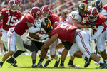 Alabama linebacker Ale Kaho (10), defensive back Patrick Surtain II (2) and defensive lineman Tevita Musika (91) stop Southern Miss running back Kevin Perkins (33) during the second half of an NCAA college football game, Saturday, Sept. 21, 2019, in Tuscaloosa, Ala. (AP Photo/Vasha Hunt)