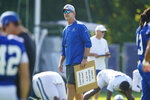 Indianapolis Colts head coach Frank Reich walks though players stretching during practice at the NFL team's football training camp in Westfield, Ind., Tuesday, Aug. 24, 2021. (AP Photo/Michael Conroy)