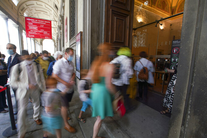 Visitors arrive on the reopening day of the Uffizi museum, in Florence, Italy, Wednesday, June 3, 2020. The Uffizi museum reopened to the public after over two months of closure due to coronavirus restrictions. (AP Photo/Andrew Medichini)