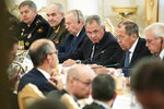 Russian Foreign Minister Sergey Lavrov, second right, and Defence Minister Sergei Shoigu, center, talk with France Foreign Minister Jean-Yves Le Drian, and Defence Minister Florence Parly, during their meeting in Moscow, Russia, Monday, Sept. 9, 2019. (AP Photo/Pavel Golovkin)