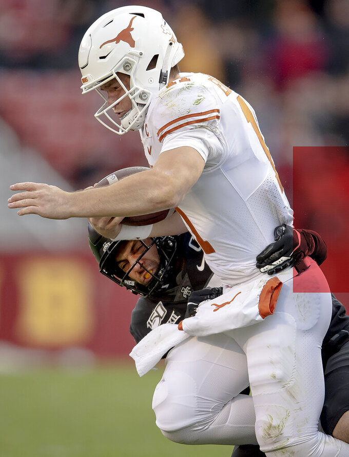 Iowa State defensive lineman Ray Lima (58) sacks Texas quarterback Sam Ehlinger (11) during an NCAA college football game on Saturday, Nov. 16, 2019, in Ames, Iowa. (Nick Wagner/Austin American-Statesman via AP)