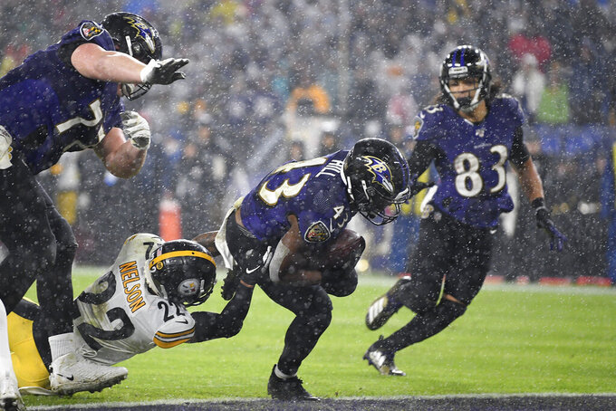 Baltimore Ravens running back Justice Hill (43) scores a rushing touchdown against the Pittsburgh Steelers during the first half of an NFL football game, Sunday, Dec. 29, 2019, in Baltimore. (AP Photo/Nick Wass)