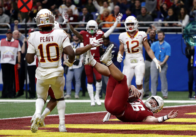 Washington State quarterback Gardner Minshew (16) dives into the end zone to score a touchdown against Iowa State during the the first half of the Alamo Bowl NCAA college football game Friday, Dec. 28, 2018, in San Antonio. (AP Photo/Eric Gay)
