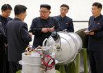 FILE - This undated file image distributed Sept. 3, 2017, by the North Korean government, shows North Korean leader Kim Jong Un at an undisclosed location.  When U.S. President Donald Trump and North Korean leader Kim Jong Un first met in Singapore in 2018, there was pomp, there was circumstance, but there wasn't much substance. As they get ready to sit down again in Vietnam on Feb. 27-28, 2019,  there's growing pressure that they forge a deal that puts them closer to ending the North Korean nuclear weapons threat. (Korean Central News Agency/Korea News Service via AP, File)