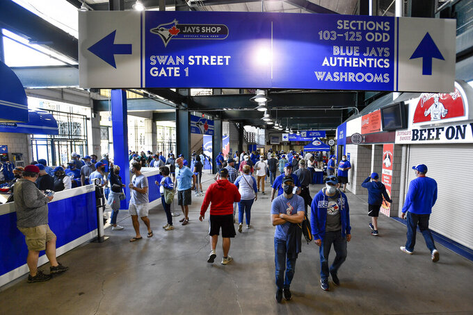 Fans walk along the concourse of Sahlen Field before a baseball game between the Toronto Blue Jays and the Miami Marlins in Buffalo, N.Y., Tuesday, June 1, 2021. (AP Photo/Adrian Kraus)