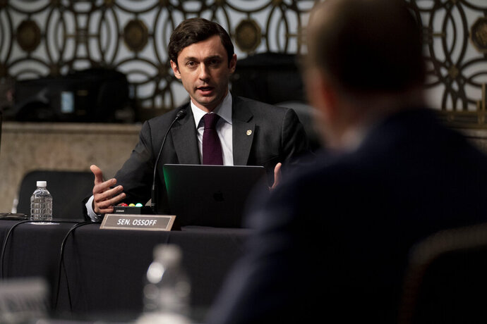 Sen. Jon Ossoff, D-Ga., questions former U.S. Capitol Police Chief Steven Sund, foreground, during a Senate Homeland Security and Governmental Affairs & Senate Rules and Administration joint hearing on Capitol Hill, Washington, Tuesday, Feb. 23, 2021, to examine the January 6th attack on the Capitol. (AP Photo/Andrew Harnik, Pool)