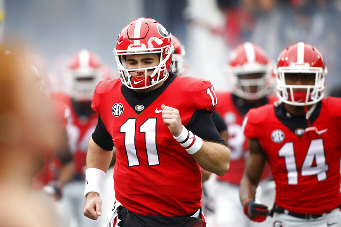 Georgia quarterback Jake Fromm (11) and his teammates take the field before the start of an NCAA college football game between Georgia and Georgia Tech in Athens Ga., Saturday, Nov. 24, 2018. (Joshua L. Jones/Athens Banner-Herald via AP)