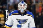 St. Louis Blues' Jordan Binnington comes back onto the ice after an open-net goal during the third period of an NHL hockey game against the Boston Bruins in Boston, Saturday, Oct. 26, 2019. (AP Photo/Michael Dwyer)