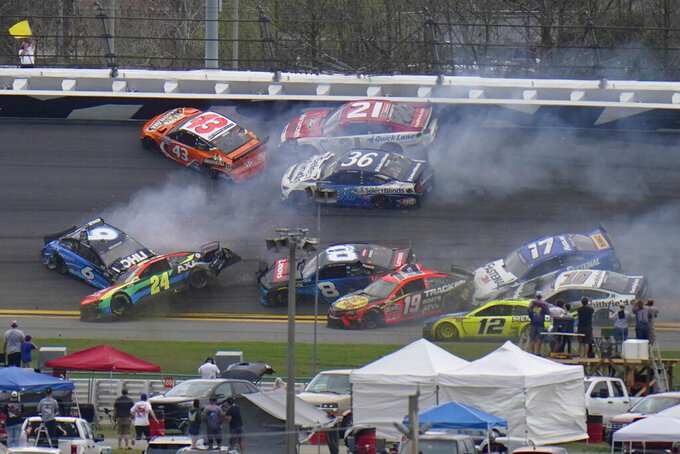 CORRECTS TO 14TH LAP, NOT 13TH AS ORIGINALLY SENT - Cars collide on the 14th lap during the NASCAR Daytona 500 auto race at Daytona International Speedway, Sunday, Feb. 14, 2021, in Daytona Beach, Fla. (AP Photo/Chris O'Meara)