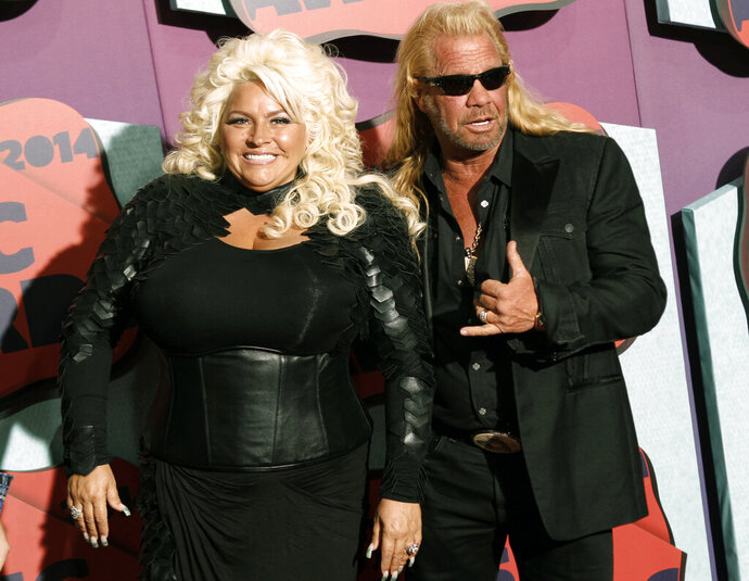 FILE - In this June 4, 2014 file photo, Beth Chapman, left, and Duane Chapman arrive at the CMT Music Awards at Bridgestone Arena, in Nashville, Tenn. Funeral services for Beth Chapman, who starred with her husband Duane in the reality TV series