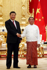 Myanmar's President Win Myint, right, shakes hands with Chinese President Xi Jinping during their meeting at the Presidential Palace in Naypyitaw, Myanmar, Friday, Jan. 17, 2020. (AP Photo/Aung Shine Oo)