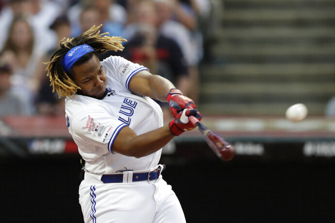 Vladimir Guerrero Jr., of the Toronto Blue Jays, hits during the Major League Baseball Home Run Derby, Monday, July 8, 2019, in Cleveland. The MLB baseball All-Star Game will be played Tuesday. (AP Photo/Tony Dejak)