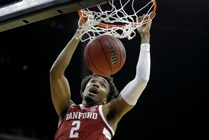 Stanford guard Bryce Wills (2) dunks the ball during the first half of an NCAA college basketball game against Butler, Tuesday, Nov. 26, 2019, in Kansas City, Mo. (AP Photo/Charlie Riedel)