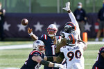 New England Patriots quarterback Cam Newton (1) passes under pressure from Denver Broncos defenders Shelby Harris, right rear, and DeShawn Williams (90) in the first half of an NFL football game, Sunday, Oct. 18, 2020, in Foxborough, Mass. (AP Photo/Steven Senne)