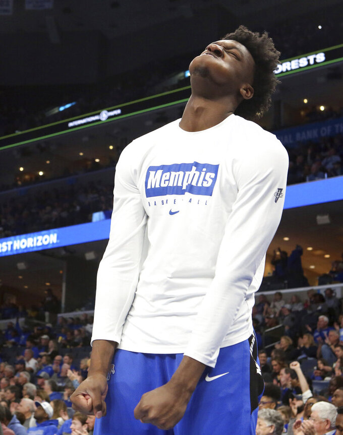 Memphis' James Wiseman reacts to a play from his spot on the bench as he sat out of an NCAA college basketball game against Alcorn State Saturday, Nov. 16, 2019, in Memphis, Tenn. (AP Photo/Karen Pulfer Focht)