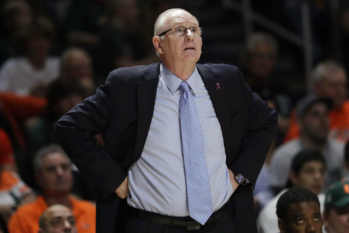 FILE - In this Nov. 5, 2019, file photo, Miami coach Jim Larranaga watches during the second half of the team's NCAA college basketball game against Louisville in Coral Gables, Fla. Larranaga, 70, is heading into his 35th year as a college coach and his 10th at Miami. He's under contract through 2023-24 and says he has no plans to retire, but acknowledges the past two seasons have been trying. (AP Photo/Lynne Sladky, File)