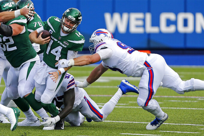 New York Jets quarterback Sam Darnold (14) is sacked by Buffalo Bills defensive end Mario Addison (97), center rear, and Harrison Phillips, right, during the second half of an NFL football game in Orchard Park, N.Y., Sunday, Sept. 13, 2020. (AP Photo/Jeffrey T. Barnes)