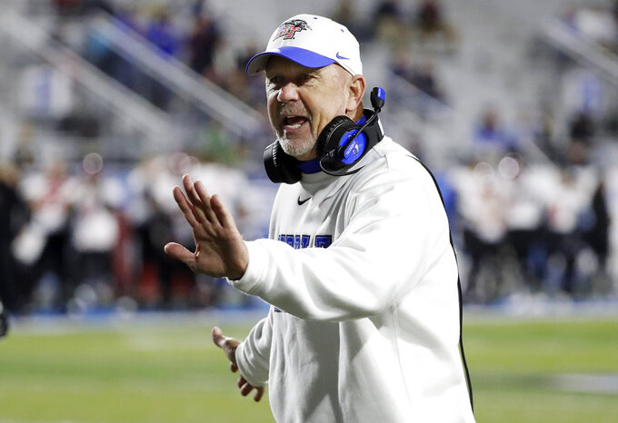FILE - In this Nov. 2, 2018, file photo, Middle Tennessee head coach Rick Stockstill congratulates his players after a touchdown against Western Kentucky in the first half of an NCAA college football game, in Murfreesboro, Tenn. Sun Belt Conference champion Appalachian State is playing in a bowl during a time of transition for its coaching staff. Middle Tennessee coach Rick Stockstill wants his quarterback son to go out a winner. Those are just two story lines surrounding Saturday night's New Orleans Bowl. (AP Photo/Mark Humphrey, File)