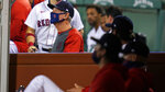 Boston Red Sox manager Ron Roenicke stands in the dugout during the ninth inning of the team's baseball game against the Baltimore Orioles at Fenway Park in Boston, Thursday, Sept. 24, 2020. (AP Photo/Charles Krupa)