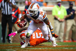 Syracuse running back Sean Tucker (34) gets past Clemson defensive end K.J. Henry (5) for a touchdown during an NCAA college football game in Clemson, S.C., on Saturday, Oct. 24, 2020. (Ken Ruinard/Pool Photo via AP)