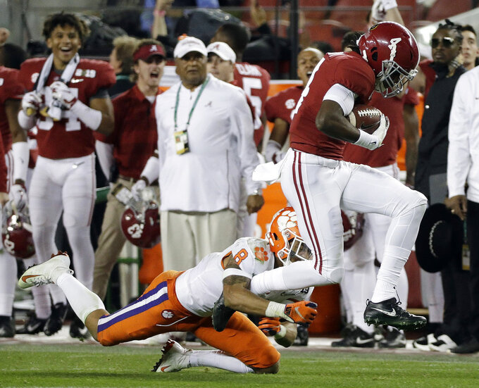 Clemson's A.J. Terrell stops Alabama's Jerry Jeudy after a catch during the second half of the NCAA college football playoff championship game, Monday, Jan. 7, 2019, in Santa Clara, Calif. (AP Photo/David J. Phillip)