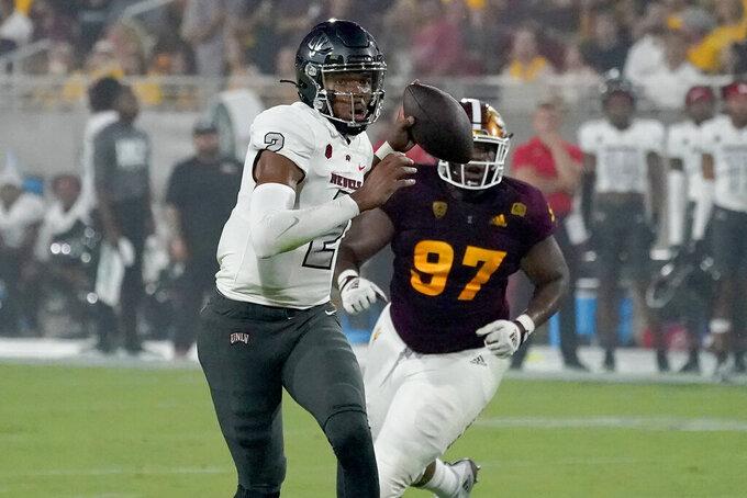 UNLV quarterback Doug Brumfield (2) scrambles as Arizona State defensive lineman Shannon Forman (97) pursues during the first half of an NCAA college football game, Saturday, Sept. 11, 2021, in Tempe, Ariz. (AP Photo/Matt York)