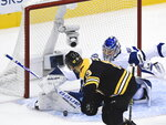 Tampa Bay Lightning goaltender Andrei Vasilevskiy (88) makes a save against Boston Bruins center Charlie Coyle (13) during the first period of an NHL hockey playoff game  Wednesday, Aug. 5, 2020 in Toronto. (Nathan Denette/The Canadian Press via AP)