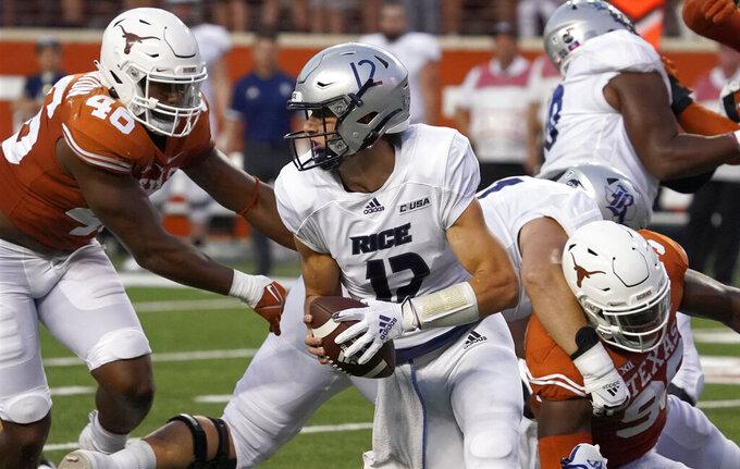 Rice quarterback Luke McCaffrey (12) scrambles away from Texas linebacker Ray Thornton (46) during the first half of an NCAA college football game on Saturday, Sept. 18, 2021, in Austin, Texas. (AP Photo/Chuck Burton)