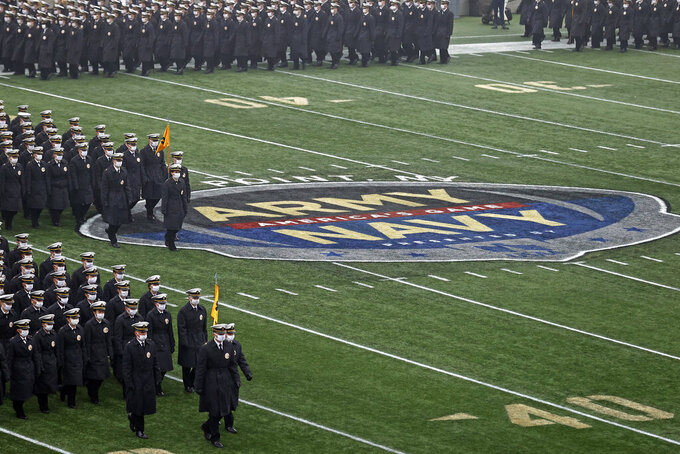 Navy midshipmen march on the field before an NCAA college football game against Army on Saturday, Dec. 12, 2020, in West Point, N.Y. (AP Photo/Adam Hunger)