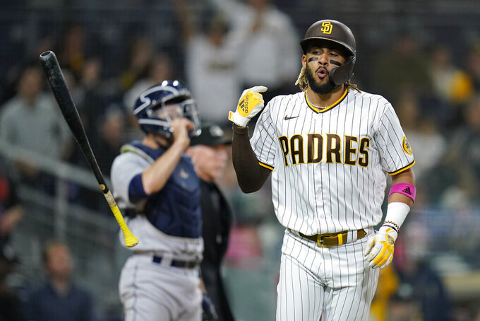 San Diego Padres' Fernando Tatis Jr. flips his bat after hitting a three-run home run during the second inning of the team's baseball game against the Seattle Mariners, Friday, May 21, 2021, in San Diego. (AP Photo/Gregory Bull)