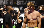 Floyd Mayweather, left, and Logan Paul pose for photographers during a weigh-in Saturday, June 5, 2021, in Hollywood, Fla. Paul will is scheduled to face Mayweather in an exhibition boxing match at Hard Rock Stadium in Miami Gardens, Fla., Sunday. (AP Photo/Jim Rassol)