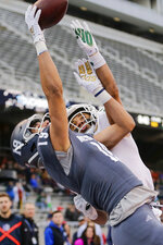 Ohio cornerback Marlin Brooks, right, tries to knock the ball away from Nevada wide receiver Cole Turner (19) on a two-point conversion try late in the second half of the Famous Idaho Potato Bowl NCAA college football game, Friday, Jan. 3, 2020, in Boise, Idaho. (AP Photo/Steve Conner)