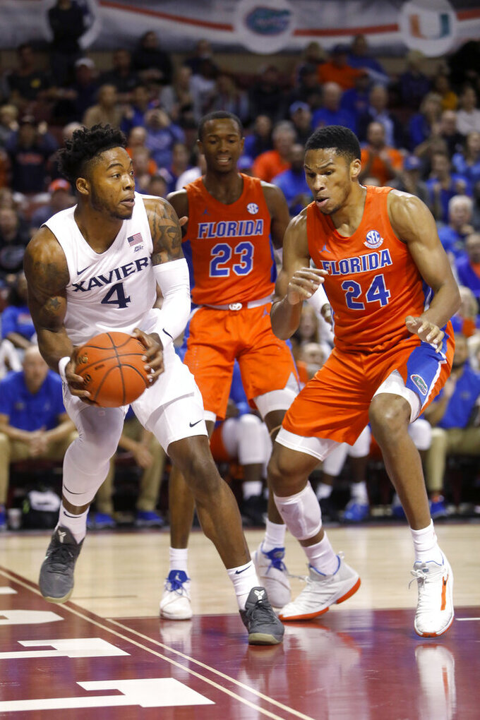 MVP Johnson leads Florida to 70-65 win over No. 18 Xavier