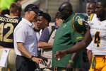 Wake Forest head coach Dave Clawson, left, and Norfolk State head coach Latrell Scott meet on the field after a NCAA college football game Saturday, Sept. 11, 2021, in Winston-Salem, N.C. (AP Photo/Chris Carlson)