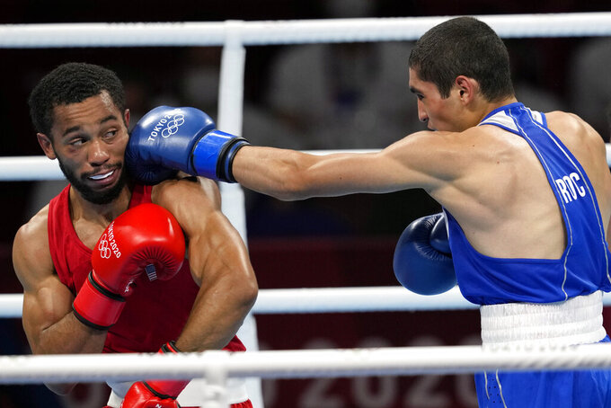 Duke Ragan, of the United States, left, takes a shot from Albert Batyrgaziev, of the Russian Olympic Committee, during their final feather weight 52-57kg final boxing match at the 2020 Summer Olympics, Thursday, Aug. 5, 2021, in Tokyo, Japan. (AP Photo/Themba Hadebe)