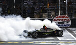 Josef Newgarden does a burnout after winning the IndyCar auto race at Texas Motor Speedway, Saturday, June 8, 2019, in Fort Worth, Texas. (AP Photo/Larry Papke)