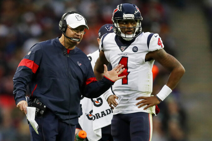 Houston Texans head coach Bill O'Brien speaks with Houston Texans quarterback Deshaun Watson (4) during the second half of an NFL football game against the Jacksonville Jaguars, at Wembley Stadium, Sunday, Nov. 3, 2019, in London. (AP Photo/Kirsty Wigglesworth)