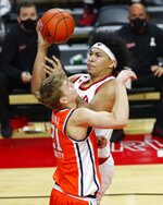 Rutgers' Ron Harper Jr. goes to the basket against Syracuse forward Marek Dolezaj (21) during the second half of an NCAA college basketball game in Piscataway, N.J., Tuesday, Dec. 8, 2020. (AP Photo/Noah K. Murray)